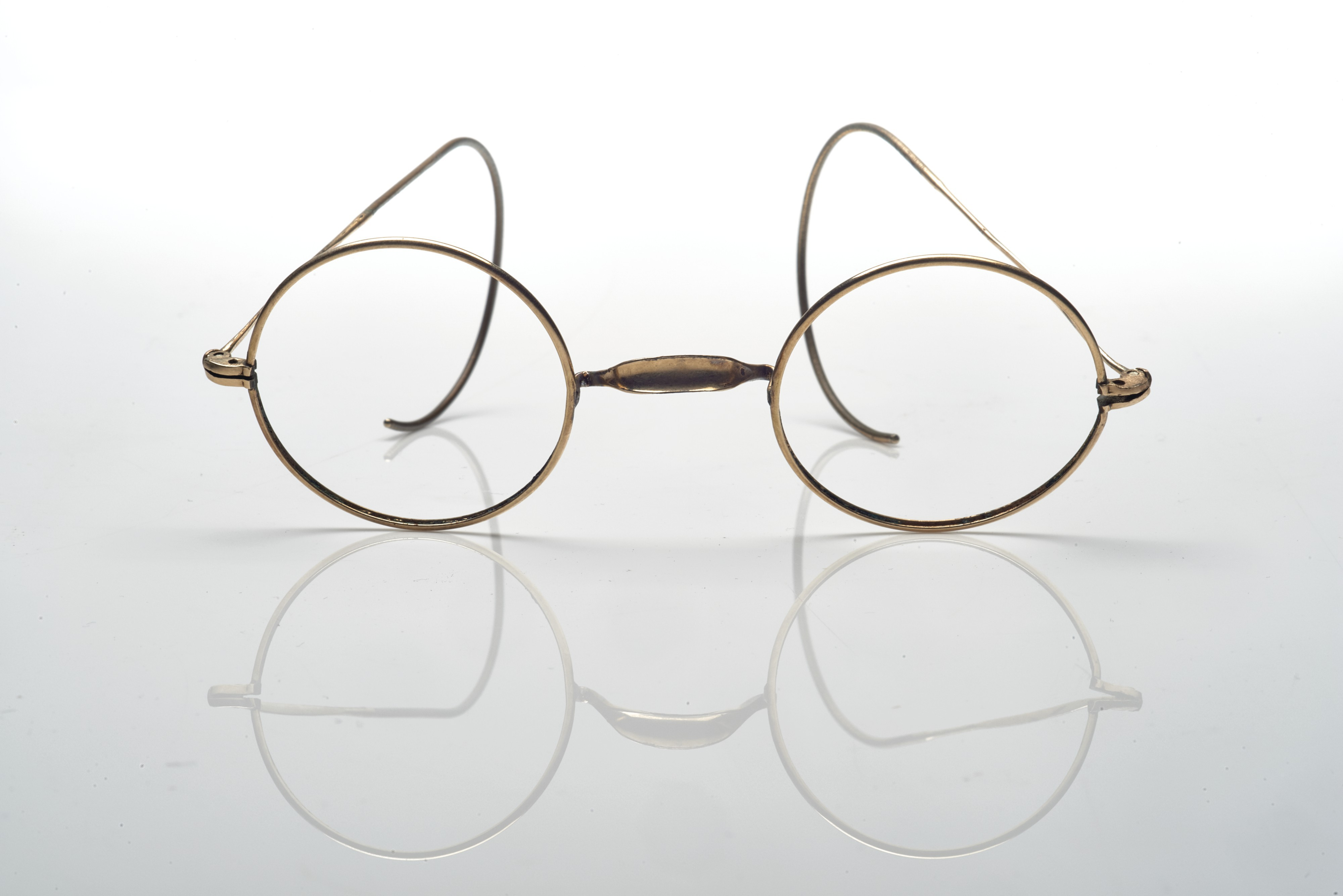 Lot 58: a pair of spectacles. A pair of golden metal spectacles, round eye wires and short temples terminating by flexible ends, illegible maker's mark. Estimate:  $1,000 - $1,500. ©Christie's Images Ltd, 2017.