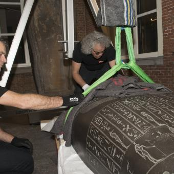 Sarcophagus being carefully moved by Crown Fine Art experts