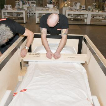 Sarcophagus being fitted into a specialist crate