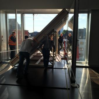 The smaller dimensions of  the museum's window required to move the work at an angle