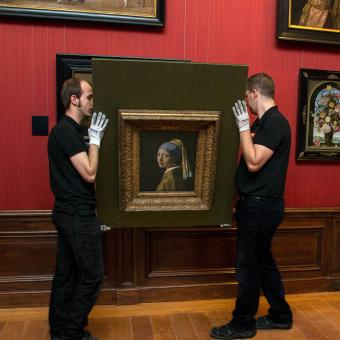 Crown Fine Art experts moving the Girl with a Pearl Earring.