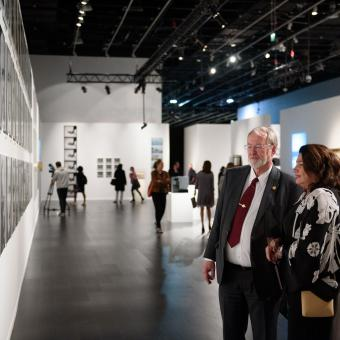 Visitors to From Barcelona to Abu Dhabi discuss the artwork on show